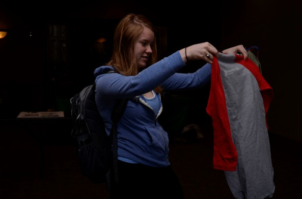 "Maddy Herries picks up a shirt at the ""Swap it Like it's Hot"" clothing swap at Stotler Lounge in Memorial Union on the University of Missouri campus Thursday, March 12, 2015.  The ""Swap it Like it's Hot"" seasonal clothing swap is put together by the Environmental Leadership Office at the University of Missouri."
