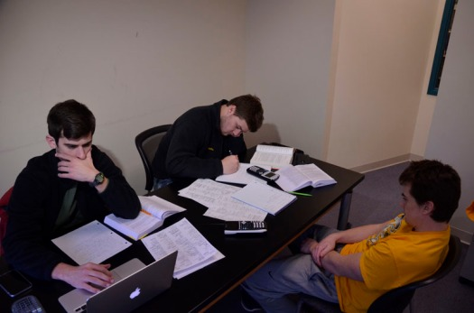 From left to right: Ethan Shearhart, David Franklin, Carter Kline study for a midterm exam in statistics in the College of Engineering library.  All three are juniors in the mechanical engineering program at the University of Missouri.