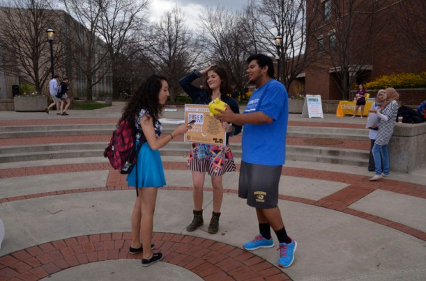 Sam A. (right) and Lily Oppenheimer talk to a University of Missouri student while collecting money for Tiger Pantry.  Tiger Pantry collects money in order to provide food and services for those in need within the the University of Missouri community.