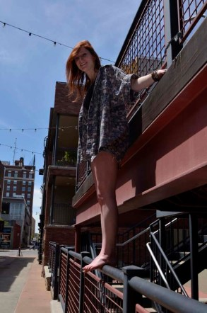 Megan Shaffer climbs on the railings of Kampai Sushi in Alley A in Columbia, Missouri, May 1, 2015.