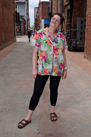 "Lindley Bennett shows off her funny patterned shirt that she piked up at a thrift store, Thursday, May 7th, 2015. ""My favorite place is probably Maude V and Goodwill. Goodwill is cheaper, but Maude V has some really cool pieces."" Maude V is located in the District of downtown Columbia.  ""I'd say about say about 55%-60% of my closet is thrifted."""